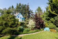 Beautiful rural house in spring garden
