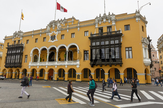 People and Tourists Crossing the Street at the Plaza Mayor in Lima, Peru
