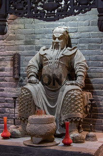 Clay statue of General Guan Yu at an altar