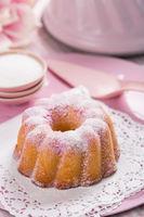 Homemade sponge pink cake with baking utensil