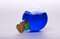 blue liquid in old style vial