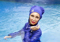 attractive woman in a Muslim swimwear  burkini  in the sea