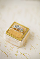 Wedding invitations and yellow ring in the velvet box