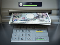 ATM machine and money. Withdrawing yen banknotes.