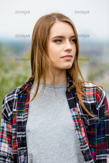 Beautiful young female in casual clothes in nature.