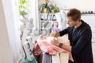 fashion designer with sewing machine working