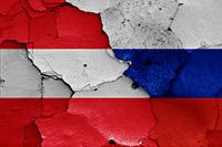 flags of Austria and Russia painted on cracked wall