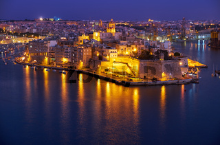 The night view of Senglea peninsula from Valletta, Malta