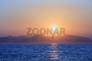 Sunset with sea and mountains