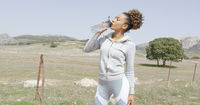 Female drinking water on workout
