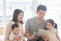 Asian people scanning QR code