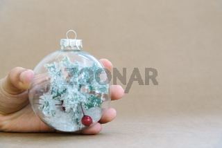 Close-up of woman hand holding Christmas bauble