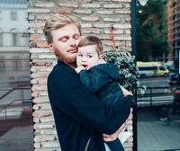 Dad with a small son in his arms