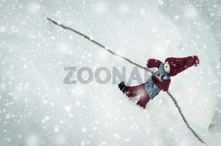Wooden little toy in winter scene