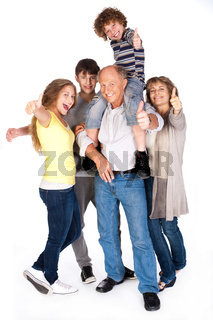 Thumbs-up family posing in style