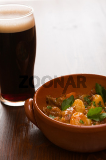 Traditional Irish Stew and a pint of beer in backlit