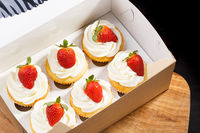 strawberry capcake in a cardboard box