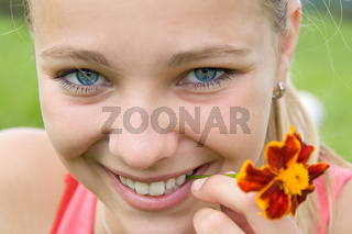 beautiful girl with small flower