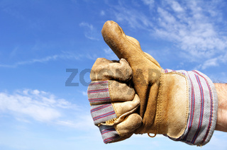 Worker Wearing Leather Work Glove Giving the Thumbs Up Sign