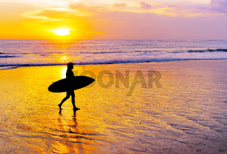 Woman surfing on tropical island