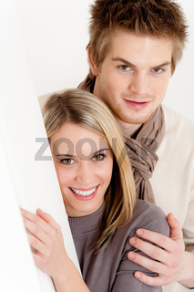 Couple in love - happy relax at home together