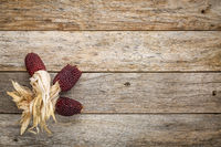 wood background with strawberry corn
