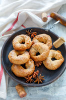 Traditional Italian wine donuts on a wooden platter.