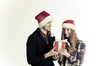 Man giving Christmas gift box to woman
