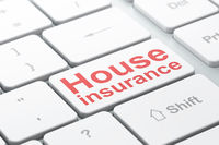 Insurance concept: House Insurance on computer keyboard background