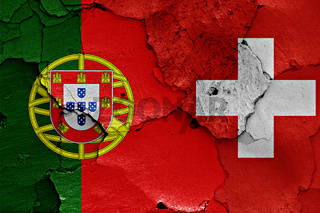 flags of Portugal and Switzerland painted on cracked wall