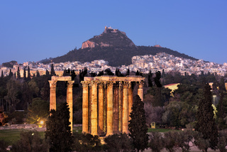 View of the Temple of Olympian Zeus and Mount Lycabettus in the Evening, Athens, Greece