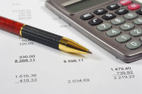 financial invoice with calculator and pen