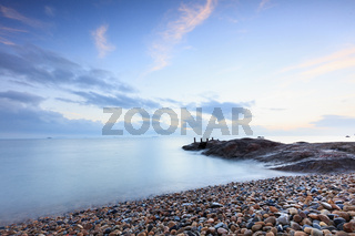 Sea sunset, small stones