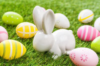 Colorful  easter eggs with an easter bunny on green grass