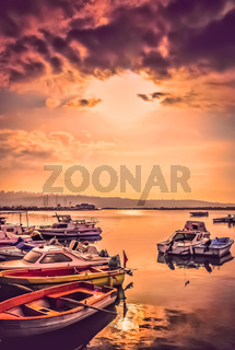 Colorful wooden fishing boats at dusk