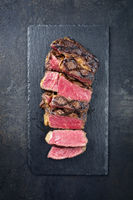 Barbecue Wagyu Entrecote sliced as close-up on a slate