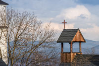 Cross on a wooden rooftop