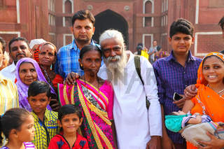 Group of local people standing outside Jahangiri Mahal in Agra Fort, Uttar Pradesh, India