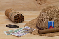 Siesta - cigars, straw hat and Cuban banknotes