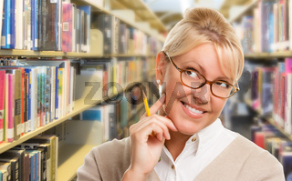 Beautiful Expressive Student or Teacher with Pencil in Library.