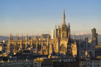 Duomo di Milano with Milan Skyline and alps on background at dawn
