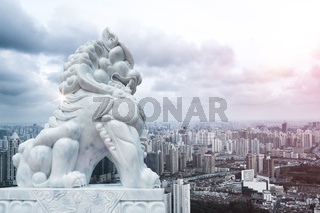 stone lion and cityscape and skyline of shanghai