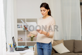 woman with papers working or learning at home