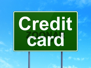 Money concept: Credit Card on road sign background