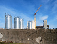 Silver silo on a construction site