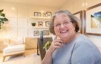 Senior Woman Inside Her Home Office.