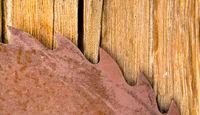Rusty Sawblade Against Wood it Was Designed to Cut