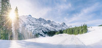 Winter sun in snowy alpine decor