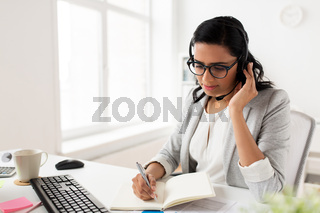businesswoman with headset talking at office