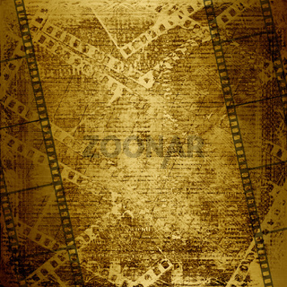 Old paper and grunge filmstrip on the abstract background